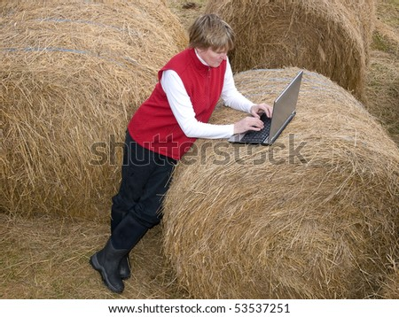 woman working wireless on her computer in the country