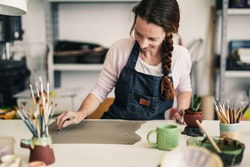 Woman working with clay - Art work studio handmade handcraft ceramic pottery