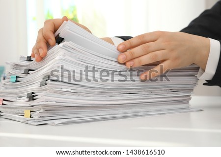 Woman working with documents at table in office, closeup Photo stock ©