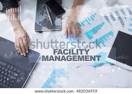 Woman working with documents, Tablet pc and notebook. Facility management Concept.