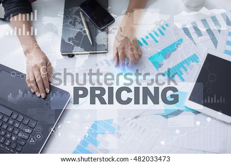 Woman working with documents, Tablet pc and notebook. Pricing Concept. #482033473