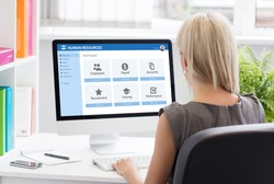 Woman working with human resources software at work