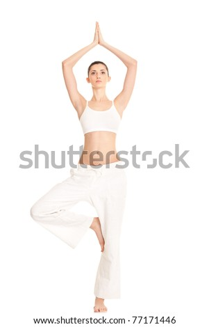 woman working  yoga exercise tree-pose, full-length portrait, isolated on white - stock photo