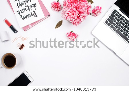 Woman workspace with laptop, handwritten quote notebook, pink carnation flower, smartphone,  lipstick on white background. Flat lay, top view. stylish female blogger concept. spring summer background. #1040313793