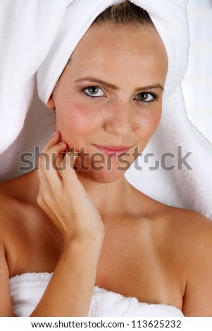 Woman wrapped in a towel while at spa
