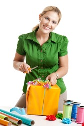 Woman wrapping a gift isolated on a white background