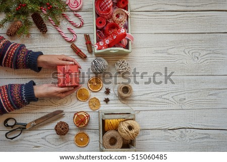 Woman wrapping christmas presents. Christmas preparations concept. #515060485