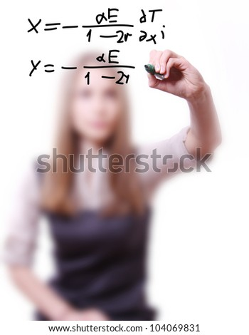 woman writes the mathematical  formula