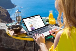 Woman writing her travel blog on laptop
