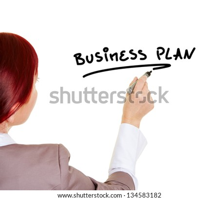 Woman writing the word Business Plan with a pen - stock photo