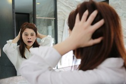 woman yawn to the mirror after wake up and go to bathroom