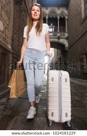 Woman 25-35 years old is walking around the city.