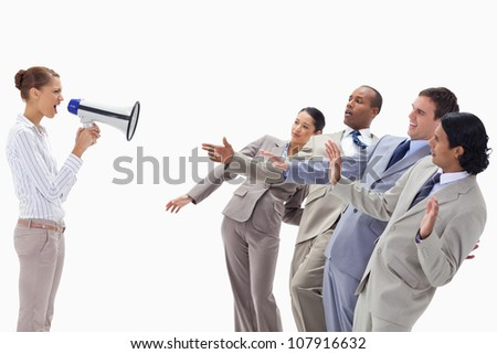 Woman yelling at co-workers through a megaphone against white background