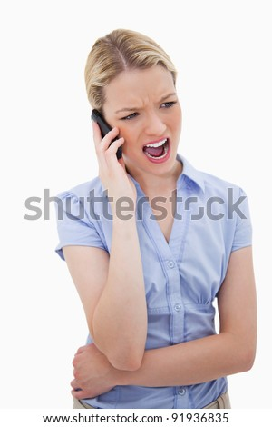 Woman yelling into her phone against a white background