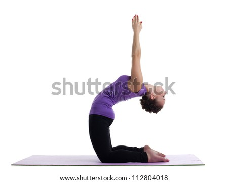woman yoga instructor posing on rubber mat - stock photo