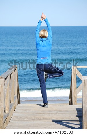 woman yoga pose at the beach