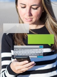 Womanan typing a message with smartphone, blurred background