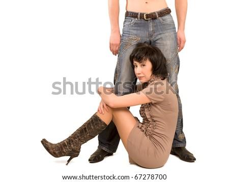womann sitting under stand man