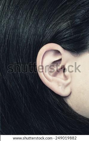 womans ear closeup