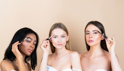 Womans eyebrows. Multi-ethnic beauty. Beautiful girls with eyebrow brush. Different types of hair and skin tones girls with natural make up. Eyebrow correction