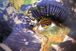 womans face with planet Earth texture and ugandan flag inside the eye. Elements of this image furnished by NASA.