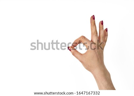 Womans hand ok sign on white background. Stock photo ©