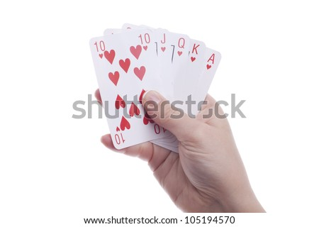 Womans' hand's holding playing cards. Royal flush. Isolated.