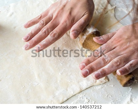 Womans hands - rolling dough