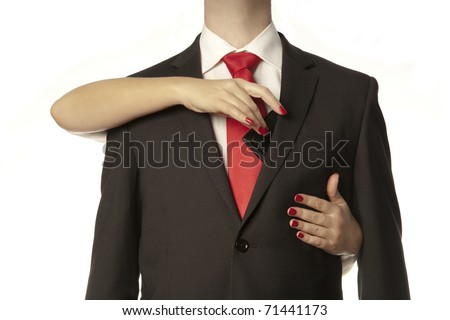 womans hands takeing our a mans leather wallet from a mans inside suit pocket