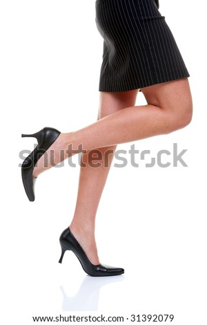 Womans legs wearing a short pinstripe skirt and black high heel shoes, on a white background.