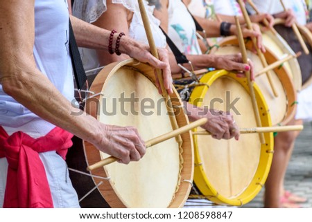 Womans percussionists playing drums during folk samba performance on Belo Horizonte, Minas Gerais #1208598847
