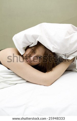 Womant in bed trying to wake up