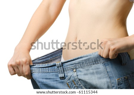 Women and jeans of the greater size. The concept of growing thin. It is isolated on a white background