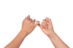 Women and man hands hook pinky fingers together to promise,Loving couple holding little fingers,Romantic moment hand in hand concept,isolated on white background