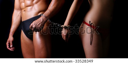 women and man with handcuffs