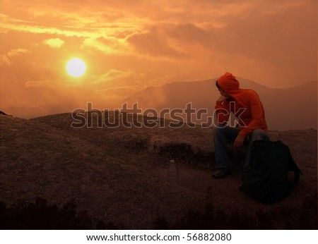 women and sunset on a mountain bacground