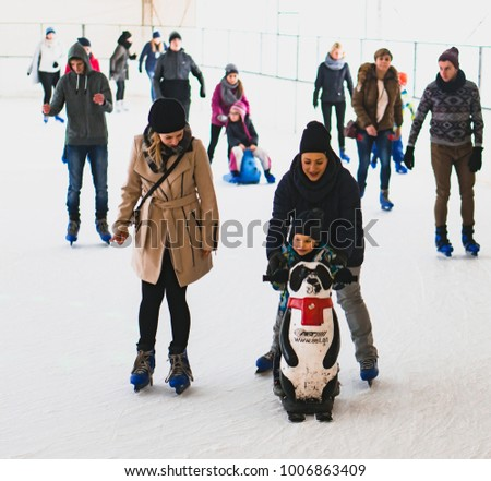 Women and toddler boy skating on ice on a cold winter day on circa January  2018 68fd0af028