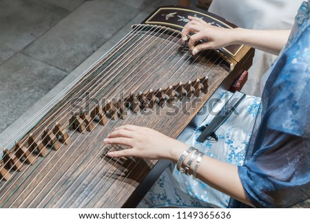 Women are playing zither, Chinese instruments #1149365636
