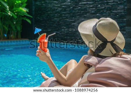 Women are relaxing at the poolside.relaxing and spa relax concept. #1088974256