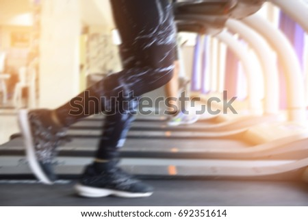 Women are running on a treadmill in the fitness room,abstract Blurry  - Shutterstock ID 692351614