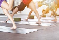 Women asian exercising in fitness studio yoga classes