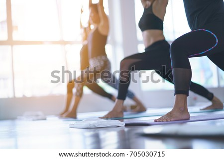 Women asian exercising in fitness studio yoga classes