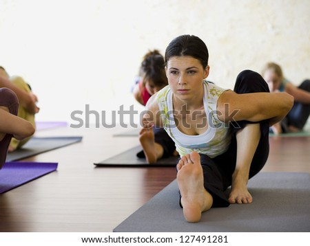 Women at yoga class stretching