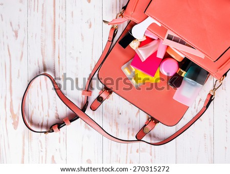 Women bag with cosmetics with medicine condoms .Save sex concept
