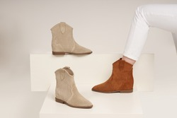 women boots in isolated white background in the studio