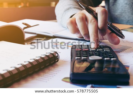 Women calculate about cost and doing finance at home office.