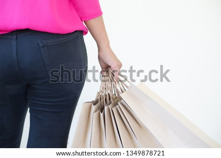 Women carry their bags after shopping to buy clothes.