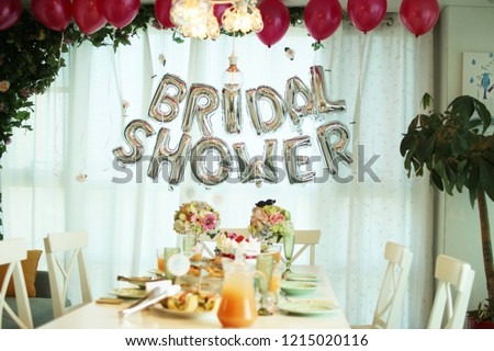 Women celebrating dessert sweets cake stand bridal shower party with friends. Stock photo ©