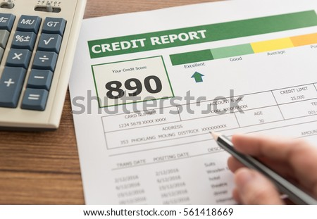 women checking credit score in credit history report. #561418669