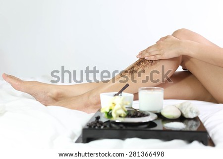 Women Cleaning skin massage with coffee grain ground  in white background
